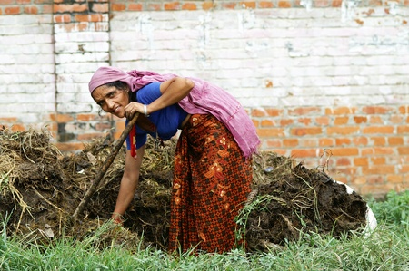 Kathmandu, Nepal - October 7, 2010: woman works the land