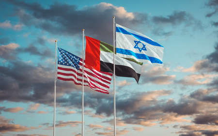 Israel, UAE and USA Flags waving against a cloudy sky background. United Arab Emirates – Israel signing historic diplomatic deal with help of US. Jerusalem and Abu Dhabi relations 2020. 3D rendering