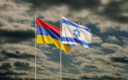 Israel and Armenian flags waving in dark sky. Symbol of relations between two countries. Armenia recalls ambassador to Israel over arms sales to Azerbaijan. Banco de Imagens