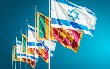 Israel and Sri Lanka flags waving in the wind against a blue sky background. Relations concept between two countries in economic and diplomatic ways.