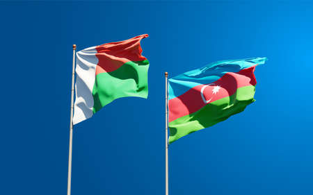 Beautiful national state flags of Madagascar and Azerbaijan together at the sky background. 3D artwork concept. Фото со стока