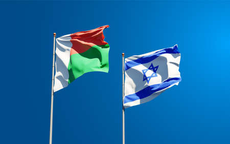 Beautiful national state flags of Madagascar and Israel together at the sky background. 3D artwork concept.