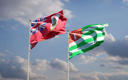 Beautiful national state flags of Abkhazia and Bermuda together at the sky background. 3D artwork concept.