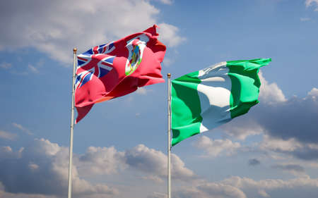 Beautiful national state flags of Nigeria and Bermuda together at the sky background. 3D artwork concept.