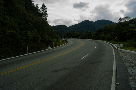 road in the mountains in a cloudy day