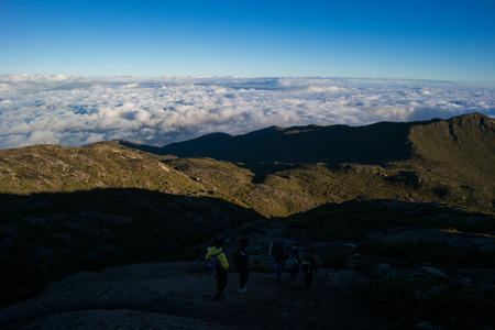 Trekking and sunrise in the mountains Banco de Imagens