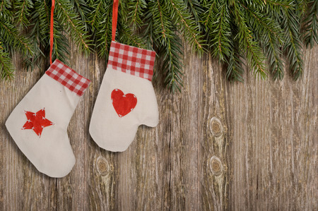 Merry Christmas decoration on wood. Gloves and Socks