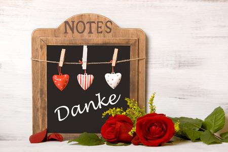 "Blackboard with writing  ""thank you "" on wood wall"