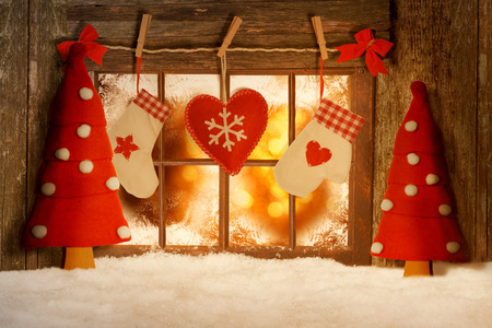 Christmas decorated window in snow
