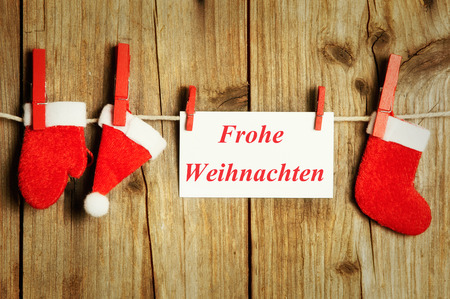 Christmas on clothesline with note, Merry Christmas on wood background