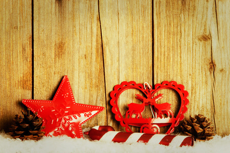 Christmas decoration in front of wood background in the snow Zdjęcie Seryjne
