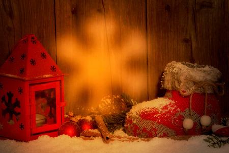Karácsonyi harisnya gyertyafényes vörös lámpás Stock fotó