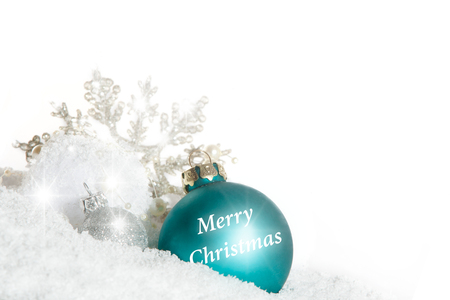 blue Christmas bauble with snow crystal isolated on white background