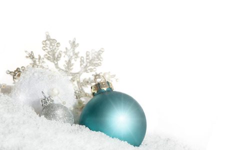 subtly: blue Christmas bauble with snow crystal isolated on white background