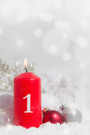 red candle in snow Christmas decoration with copy space