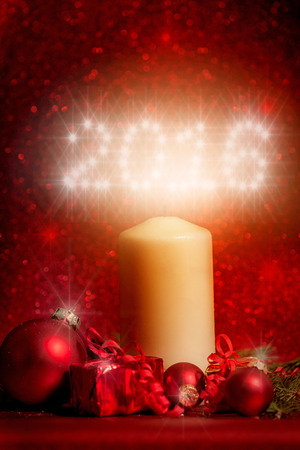 white candle / candle light 2016 red background with bokeh Zdjęcie Seryjne