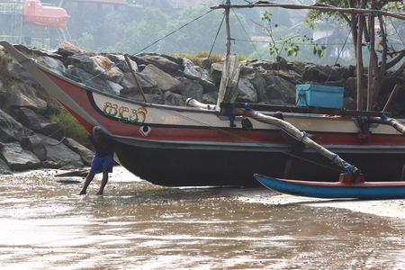 harbors: Fishers have to drag their fishing boats back to the beach due to without proper harbors nearby. Editorial