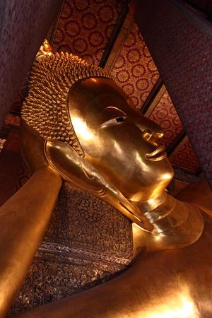 reclining: Reclining Buddha statue. Wat Pho, Bangkok, Thailand Stock Photo