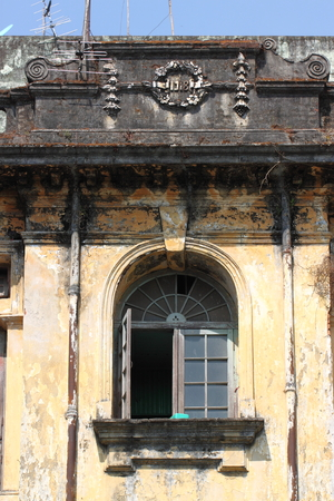 colonial building: A street architecture view with colonial building in the town of Yangon, Myanmar