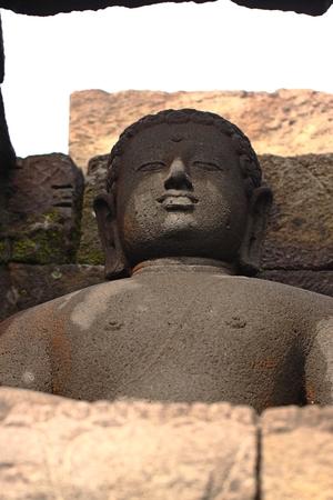 Buddha statue in stupa, Borobudur, near Yogyakarta, Java, Indonesia Stock Photo