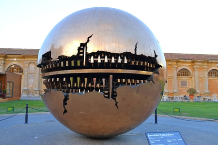 VATICAN VATICAN- June 13 2017 : Enclosed court of the Vatican ,a bronze sculpture by Italian sculptor Arnaldo Pomodoro Italy