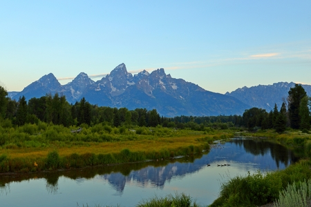 The Grand Teton sunrise reflection at Schwabacher's Landing in Grand Teton National Park, WY