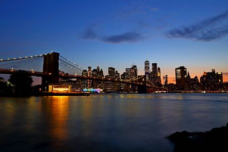 Brooklyn Bridge and Downtown Manhattan at at sunset