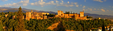 Panoramic view of Alhambra palace at sunset Granada - Andalusia, Spain, viewed from Mirador San Nicolas.