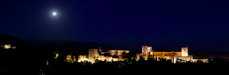 Panoramic view of Alhambra palace in the blue hours, Granada - Andalusia, Spain, viewed from Mirador San Nicolas.