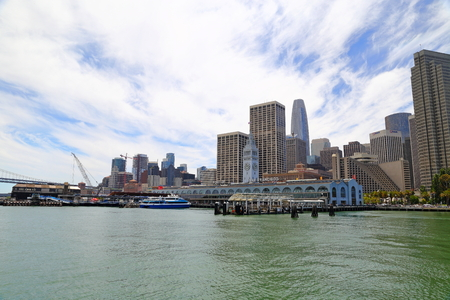 Clock tower of Ferry Building and financial center downtown in San Francisco Editorial