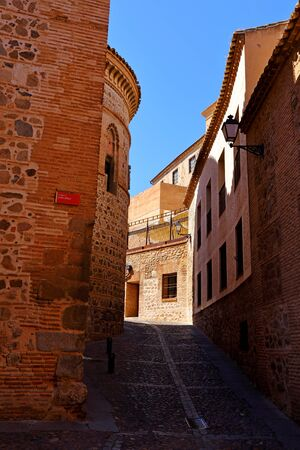 Traditional old Spanish street, in the historic city of Toledo, Spain. Stock Photo