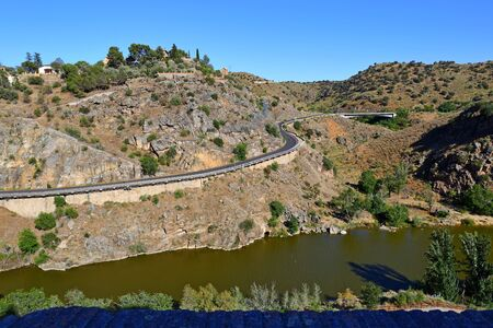 Traditional old Spanish highway road, in the historic city of Toledo, Spain.