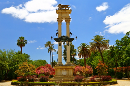 Monument of Christopher Columbus decorated with the prows of two ships and a lion in the garden de Murillo in Seville, capital of Andalusia, Spain, Editorial