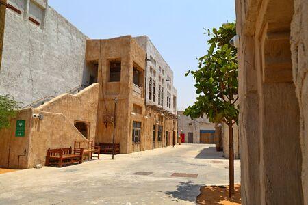 Old Dubai of buildings and traditional Arabian streets. Historical Al Fahidi neighborhood, Al Bastakiya in Dubai.