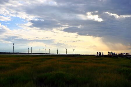 Gaomei wetlands during sunset with wind turbine background in Taiwan