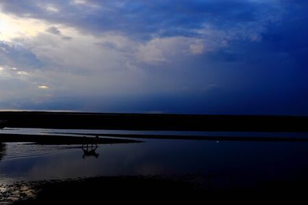 Gaomei wetlands during sunset with wind turbine background in Taiwan Taichung,