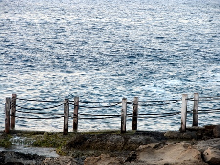 fence on the shore of the sea