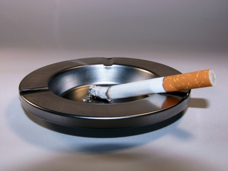 smoldering: Cigarette and ashtray