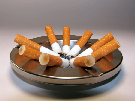 smoldering: Cigarette butts and ashtray