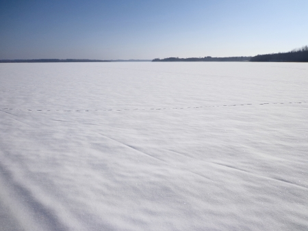 snowcovered: Snow-covered surface on the frozen lake