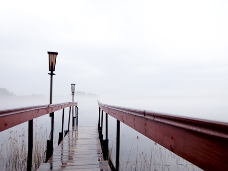Footbridge: The footbridge to the lake in foggy weather Stock Photo