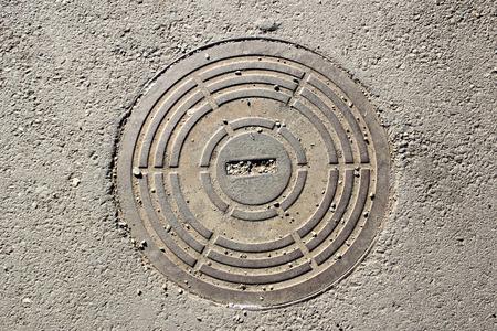 manhole: Manhole cover on the asphalt surface