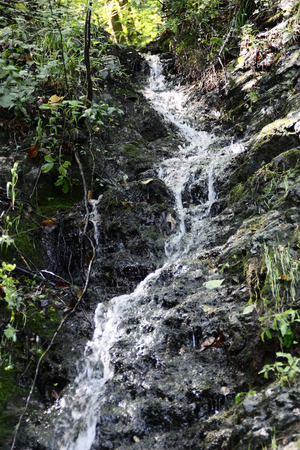 the crags: Rocky mountain slope and stream of the water