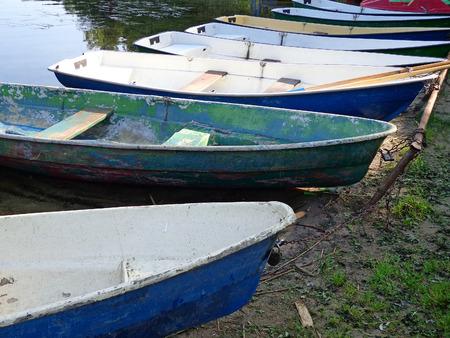 berth: Boats at the berth on the shore of the lake