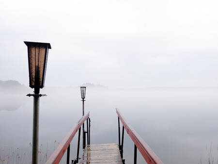 batten: The footbridge to the lake in foggy weather Stock Photo