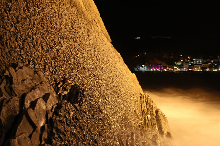 crag: Night view of the rock sea and lights of the seaside town