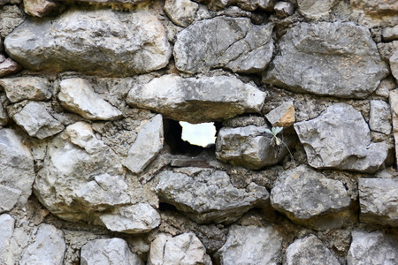loophole: Loophole in the wall of the ancient fortress