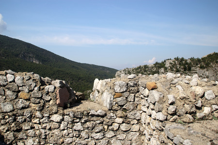 embrasure: The wall of the ancient fortress Stock Photo