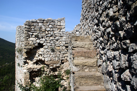 The stone stairs and the walls of the ancient fortress Stock Photo