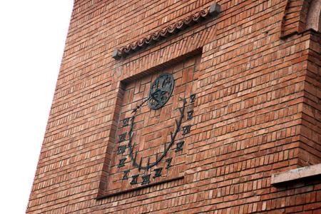 sundial: Sun-dial on the brick wall